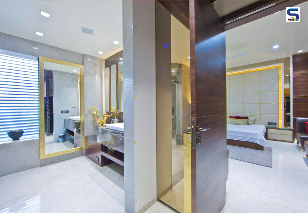 For the daughter's bathroom, the parent's princess, a pristine onyx stone was chosen in shades of honey. The reflection in this stone is so clear that it feels like one is walking off the floor. Pattern in grey and white hues add a more contemporary and up-to-date character to this space. The round mirrors further the feminine temperament.