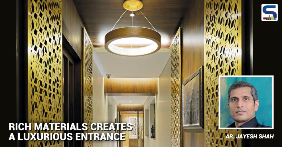 This is the entry passage of a residence in South Mumbai. Since the passage is long and narrow, a full length mirror is used effectively to widen up the space at the main door.