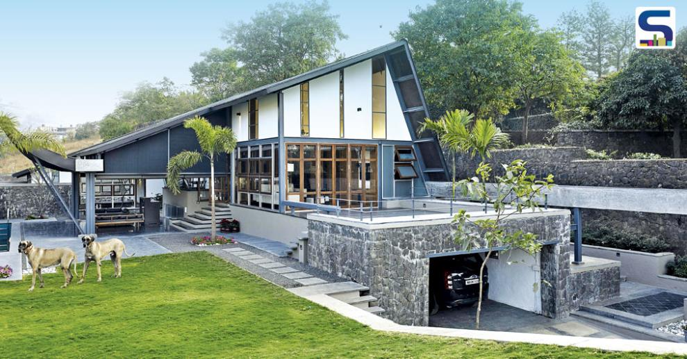 Located on a 10,000 sq ft plot, this amazingly stunning roof house has a high retaining wall on one side.