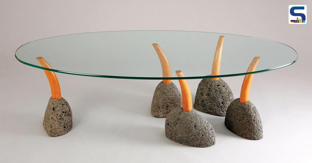 Seth Rolland's sprout coffee table is made from natural stone and sustainably harvested wood.  Three of the legs are set at a fixed height, with additional ones adjustable to accommodate uneven floors.