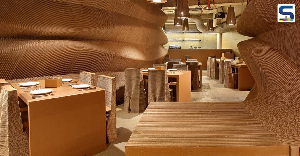 Sited in Mumbai's central business district, Bandra Kurla Complex, Cardboard Bombay is a cafetaria located on the ground floor designed by Nuru Karim, the founder of Nudes- an Indian Architecture Studio