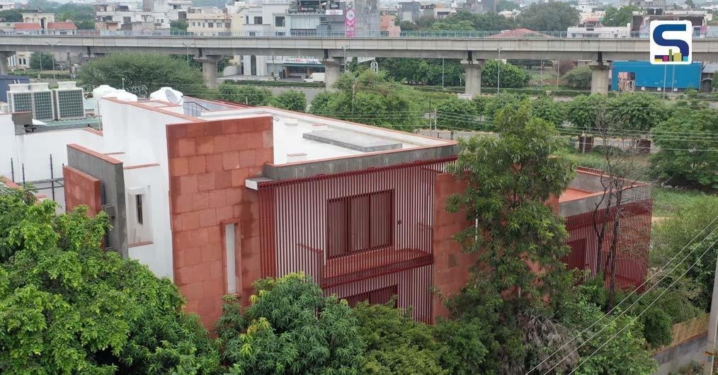 The Red Sandstone Façade of This House in Gurgaon Emerges From Within The 49 Trees | Renesa