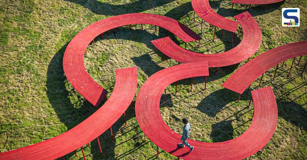 Eight Curved Elevated Red Walkways | Bangkok Project Studio