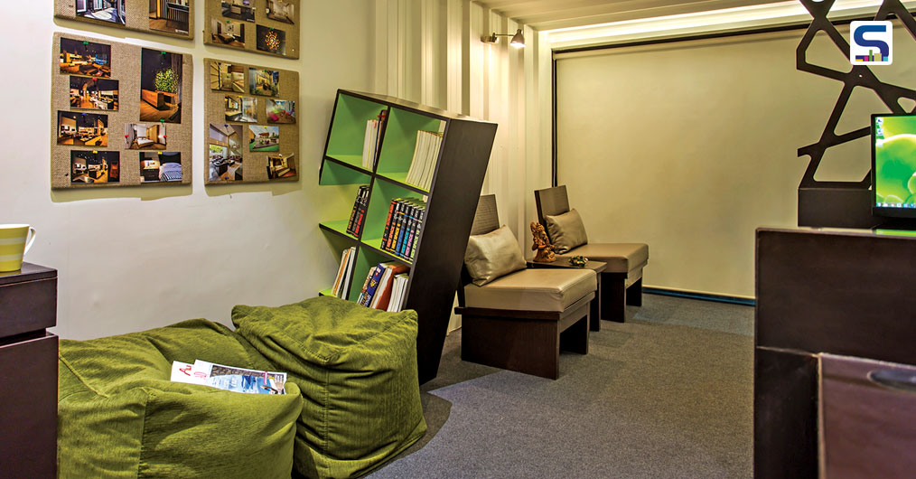 As per client's requirement small library unit is created next to the waiting area. This unit is designed in a manner to give impact that the unit itself emerges from the wall. Green beanbags are provided to use library unit efficiently.