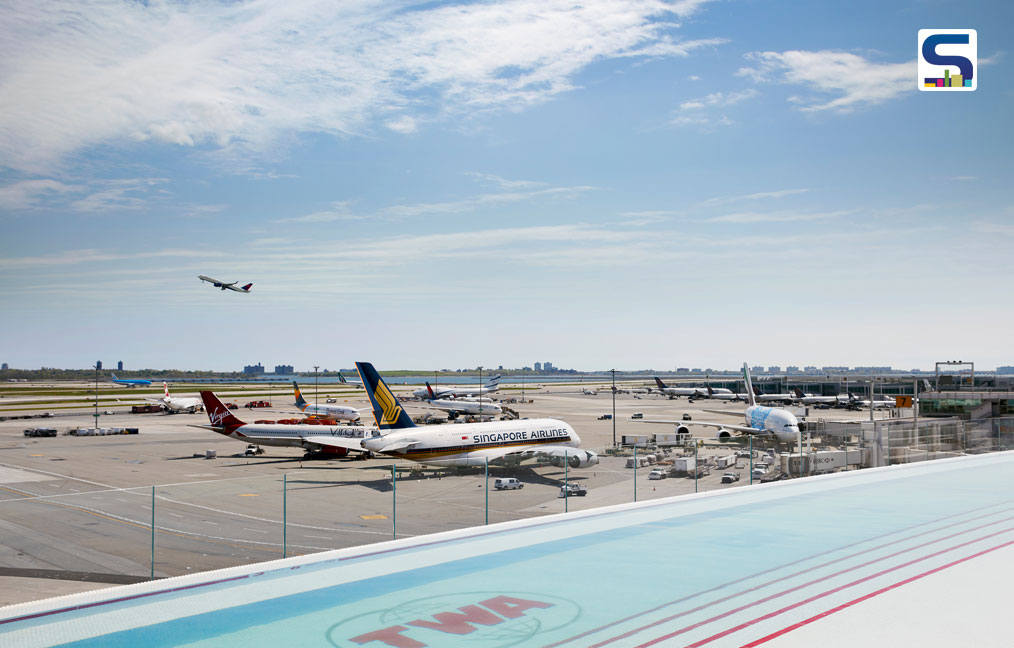The TWA Hotel's rooftop infinity pool and observation deck overlooks JFK's bustling Runway 4 Left/22 Right.