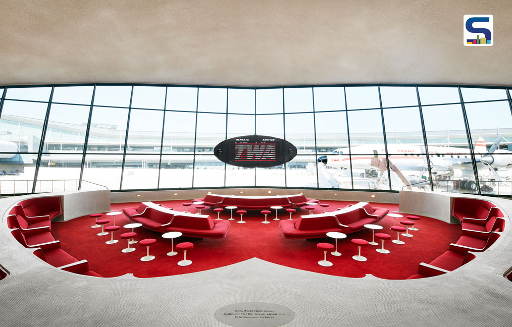The Sunken Lounge at the TWA Hotel features its original Chili Pepper Red carpet and authentic penny tile.