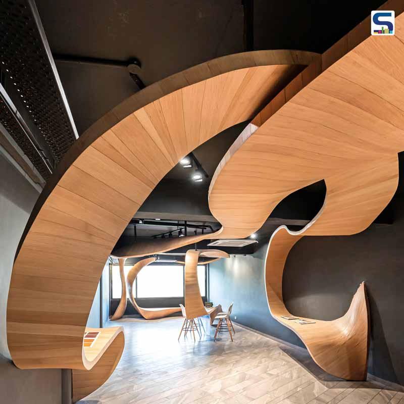 Hand-Carved Timber Flows Like Ribbon in the Interiors of This Retail Shop | Timber Rhyme